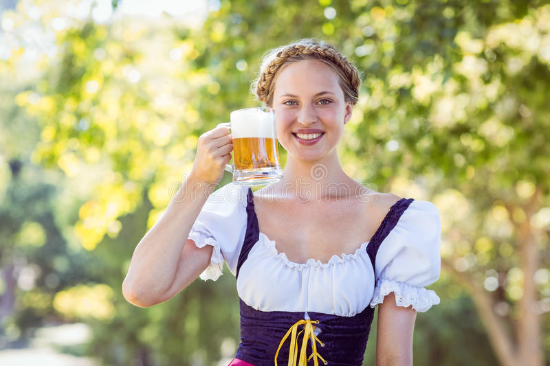 Pretty oktoberfest blonde toasting in the park stock images