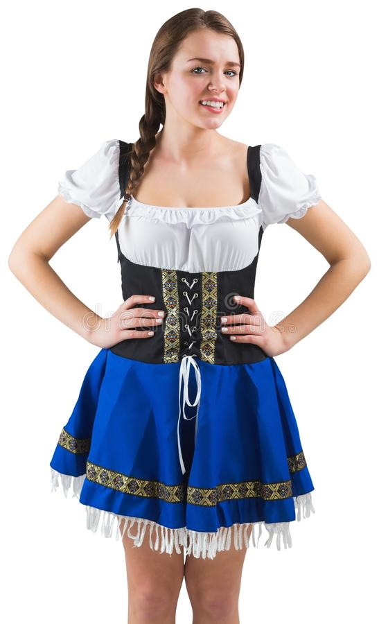 Pretty oktoberfest girl with hands on hips royalty free stock image