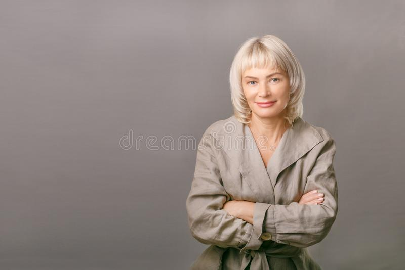Pretty older business woman, successful confidence with arms crossed stock photos