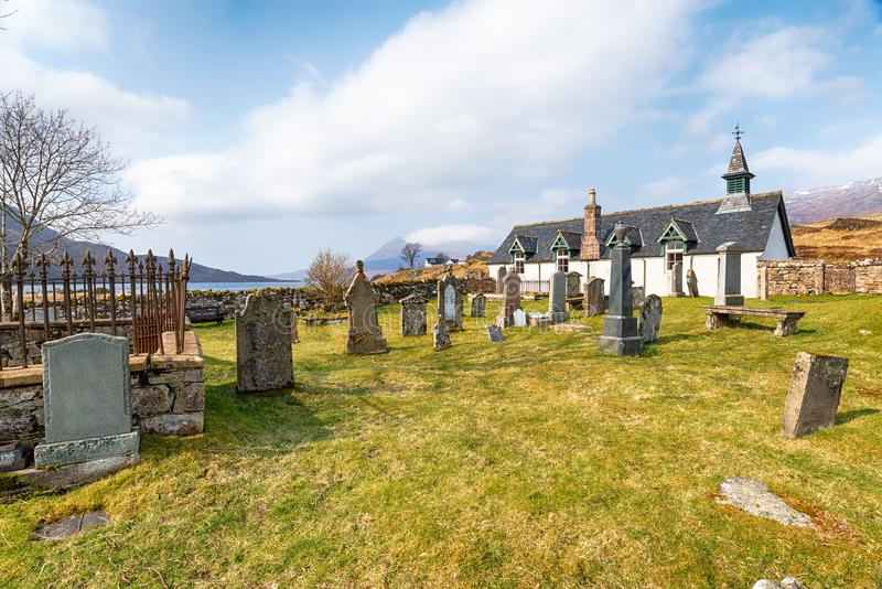 Old Kirk at Inchnadamph. The pretty parish church Old Kirk at Inchnadamph on the shores of Loch Assynt in North West Sutherland in Scotland and on the NC500 stock photos