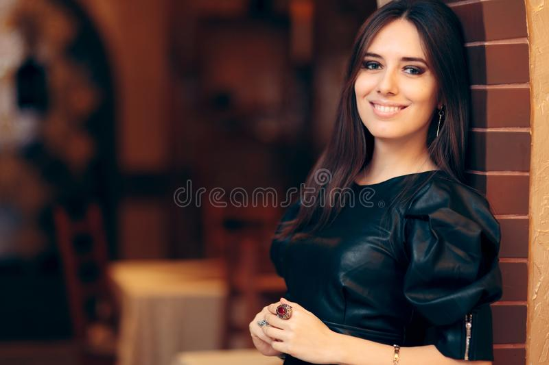 Portrait of a Beautiful Woman Wearing Faux Leather Dress royalty free stock images