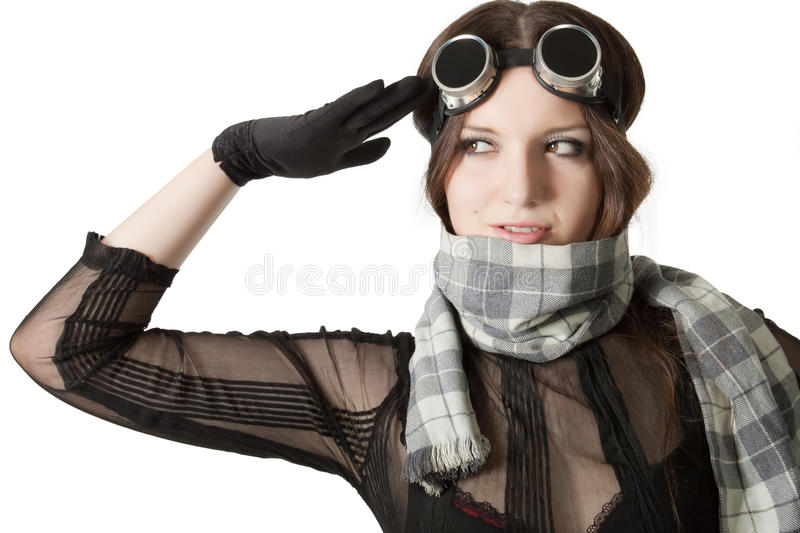 Pretty pilot in scarf saluting over white. Prety pilot in scarf and googles saluting over white stock images