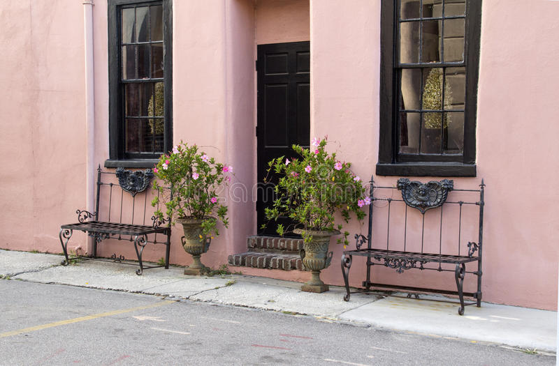 Pretty pink building and benches royalty free stock photos