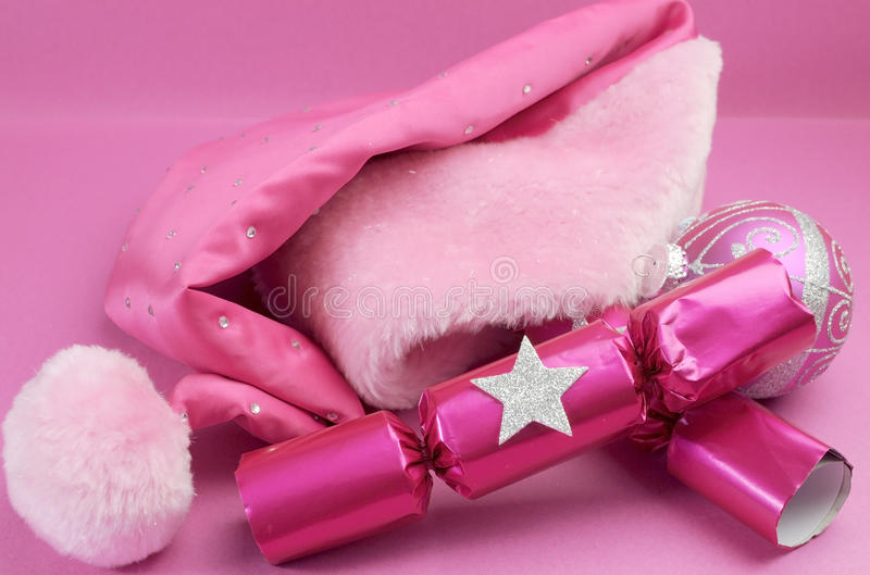Pretty pink feminine santa hat with festive Christmas decoration royalty free stock images