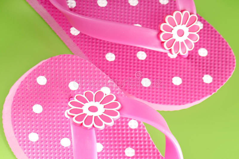 Pretty pink flip flops stock photo