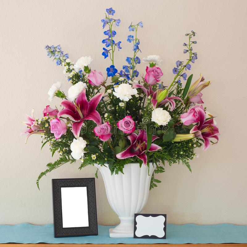 Pretty Pink and Lavender Flower Bouquet in White Vase with Blank Picture Frame and Name Card with room or space for your words, te stock images