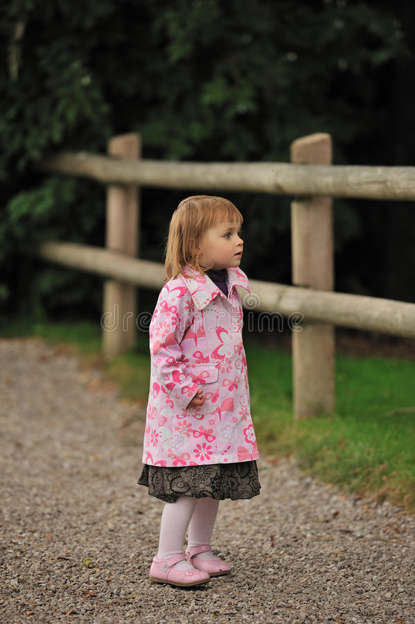 Pretty in Pink. A little girl wearing a pink coat stock photography