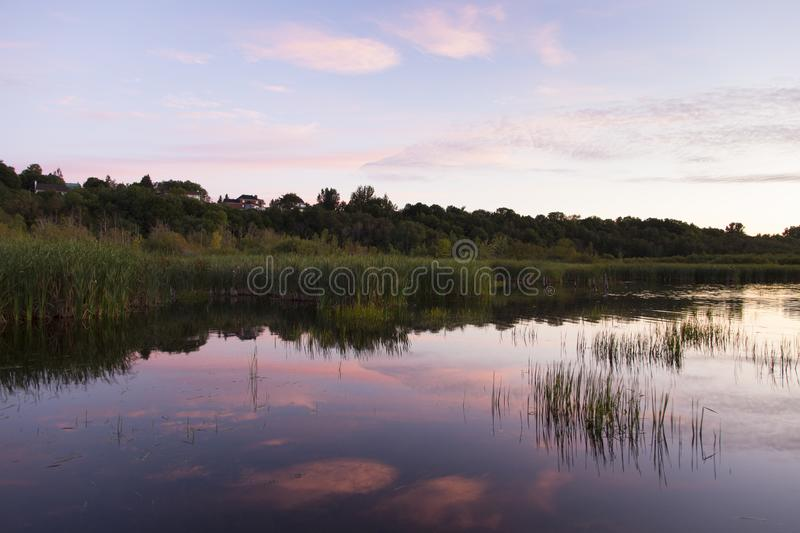 Pretty pink sunrise on the Léon-Provancher marsh during late summer. Neuville, Quebec, Canada, Neuville, Quebec, Canada royalty free stock image
