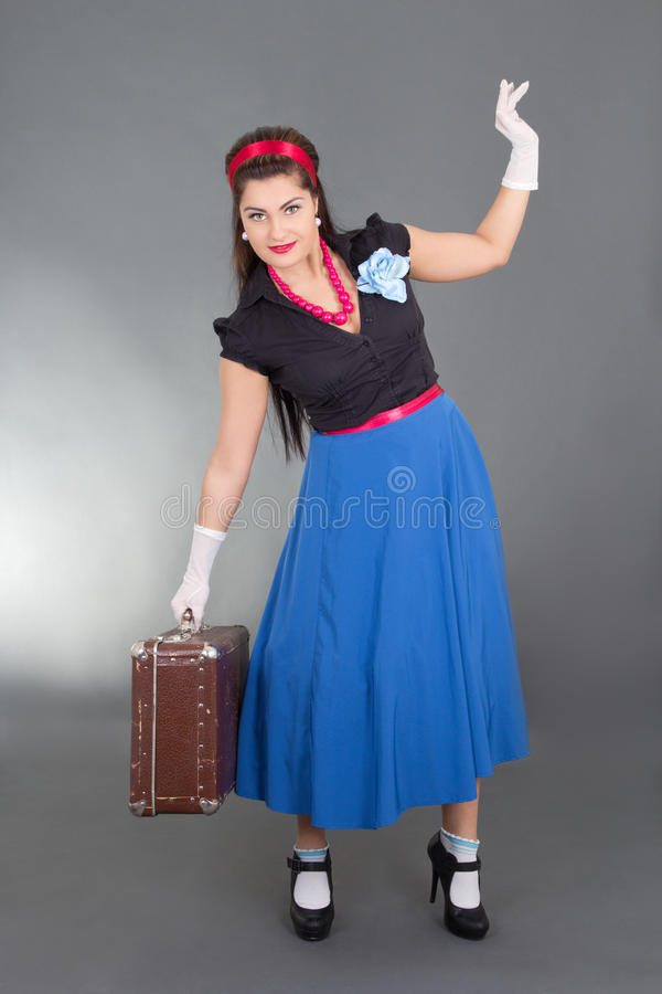 Pretty pinup girl with retro suitcase stock images