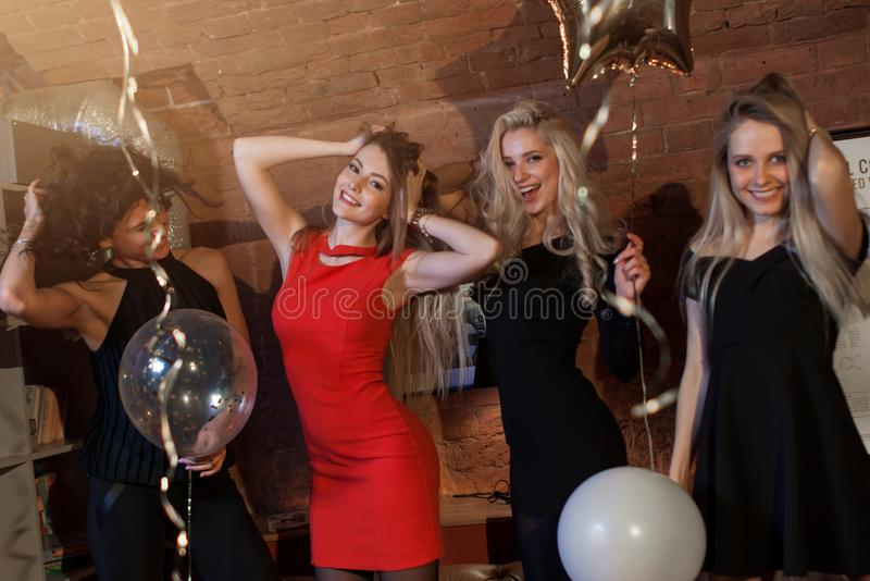 Pretty positive girls having fun dancing in nightclub royalty free stock photos