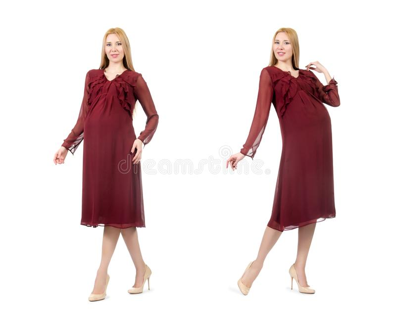 The pretty pregnant woman in red dress isolated on white stock photos