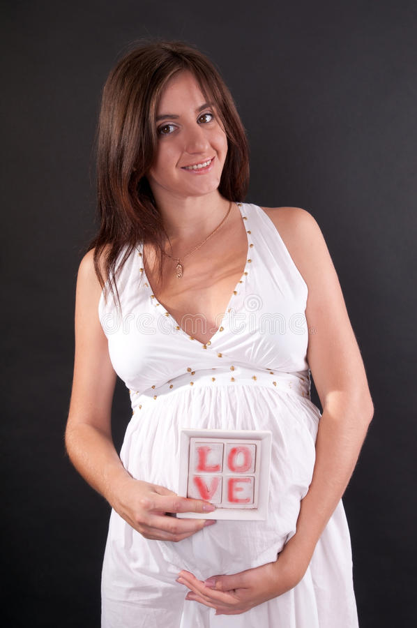 Free Pretty Pregnant Woman With Tablet Royalty Free Stock Image - 52105906