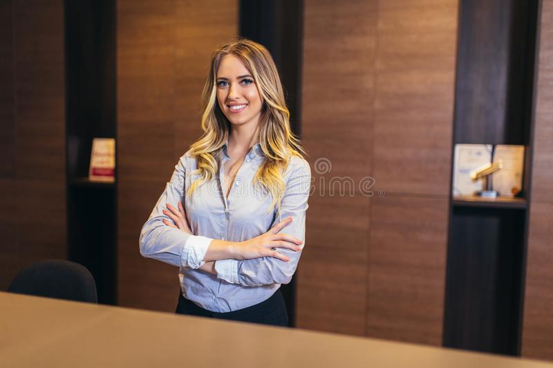Pretty receptionist at work stock photo