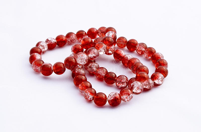 Pretty red bracelets royalty free stock photos