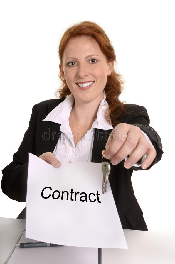Pretty red-haired business woman with contract and keys royalty free stock image