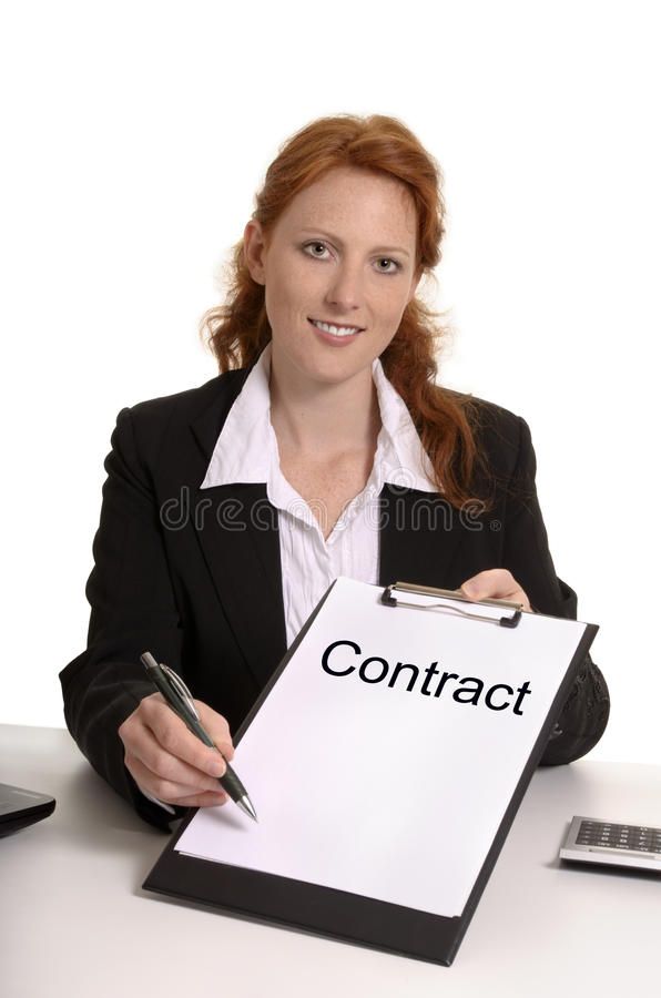 Pretty red-haired business woman with contract royalty free stock images