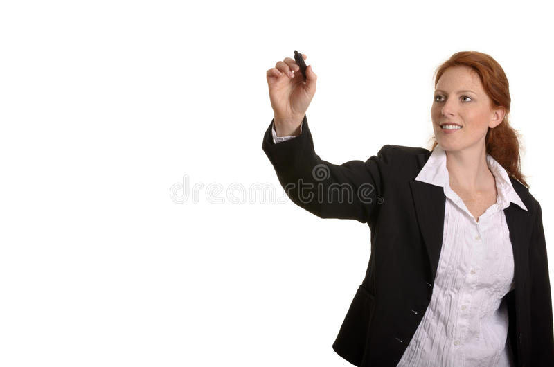 Pretty red-haired business woman writing with pen stock photo