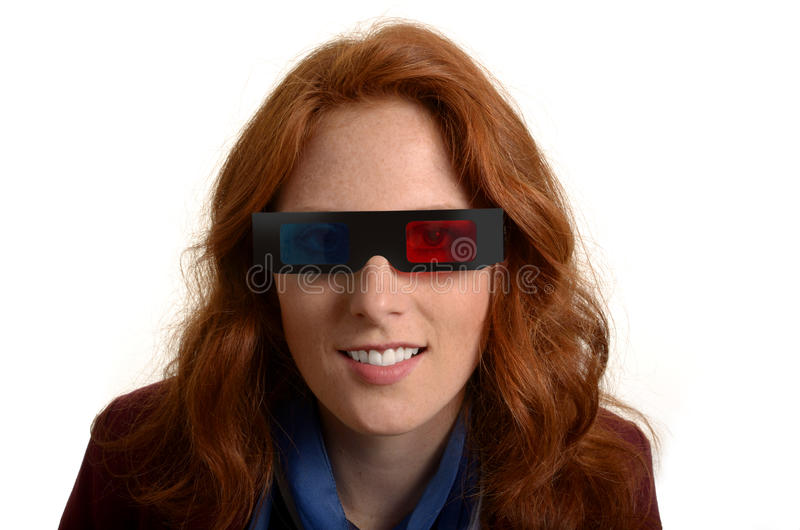 Pretty red-haired woman with 3D glasses royalty free stock image