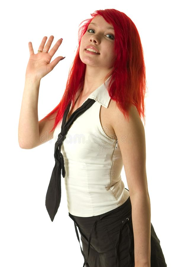 Pretty redhead girl raising hand stock images