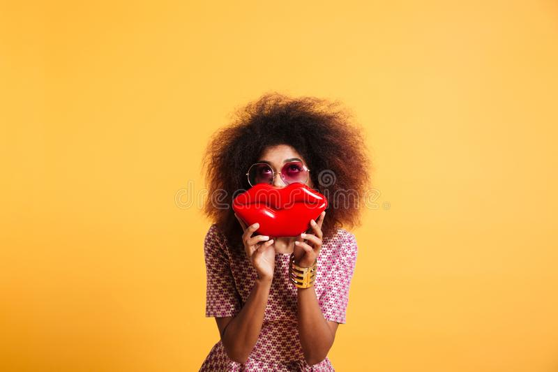 Pretty retro stylish african woman having fun while posing with stock photography
