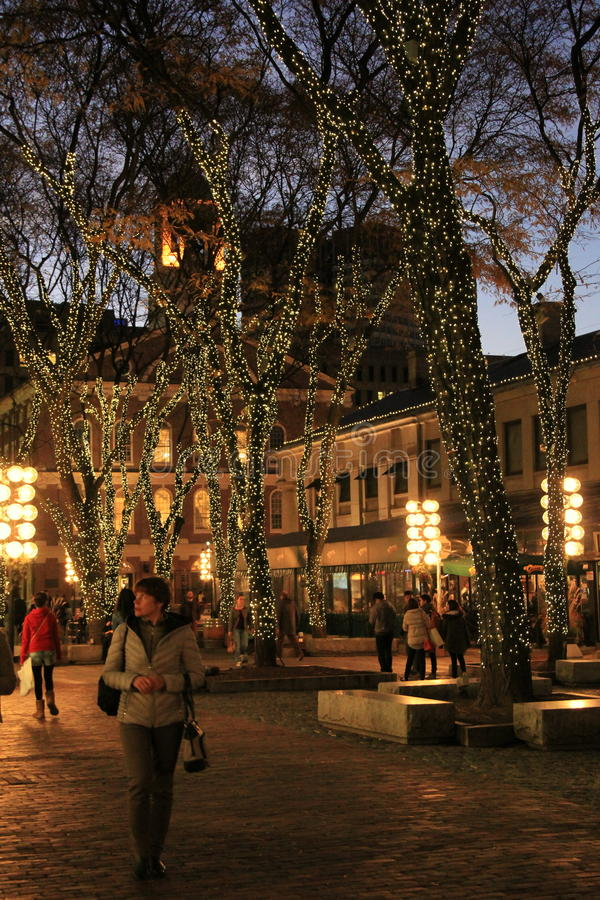 Pretty scene of people strolling through Faneuil Halll at night,Boston,December,2014 stock image
