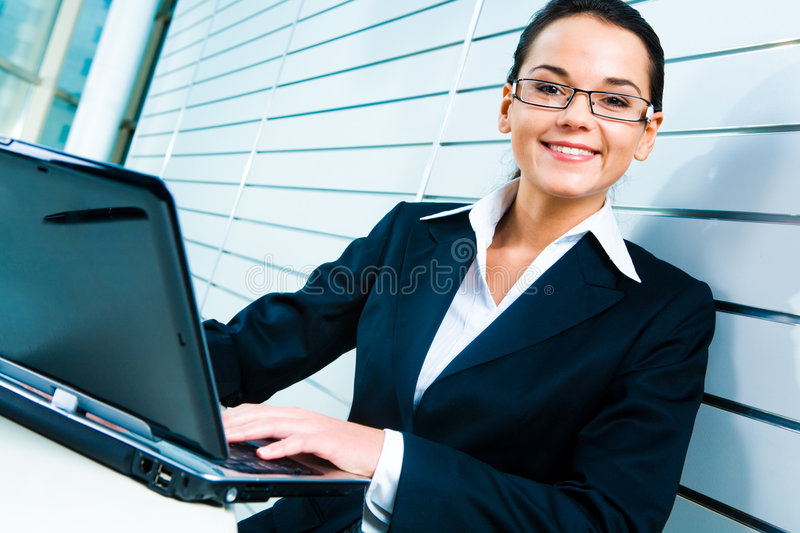 Pretty secretary. Face of pretty secretary with glasses looking at camera royalty free stock photos