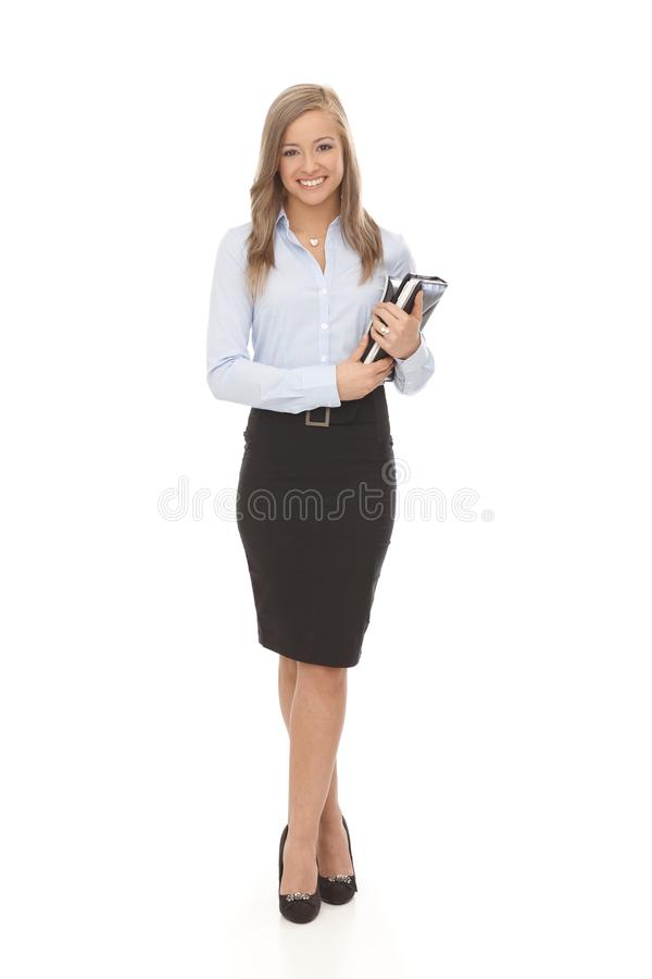 Pretty secretary full size. Pretty secretary holding personal organizer, smiling. Full size royalty free stock images