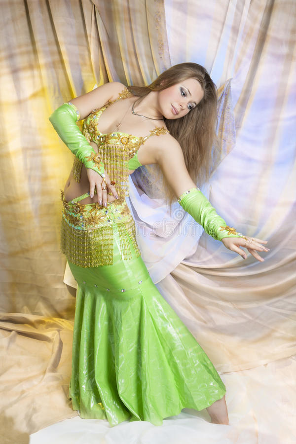 Pretty sexual blond doing belly dance royalty free stock images
