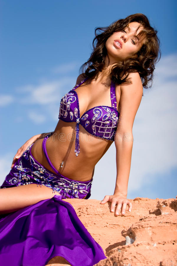 Pretty bellydancer. Beautiful bellydancer in the desert royalty free stock images