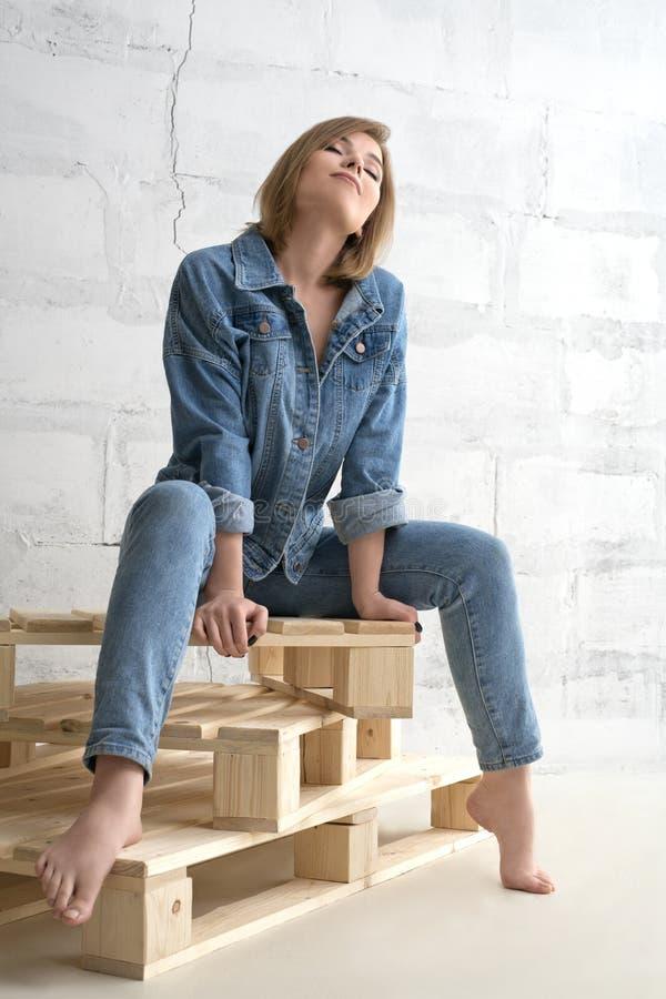 Pretty girl in jeanswear shot stock image