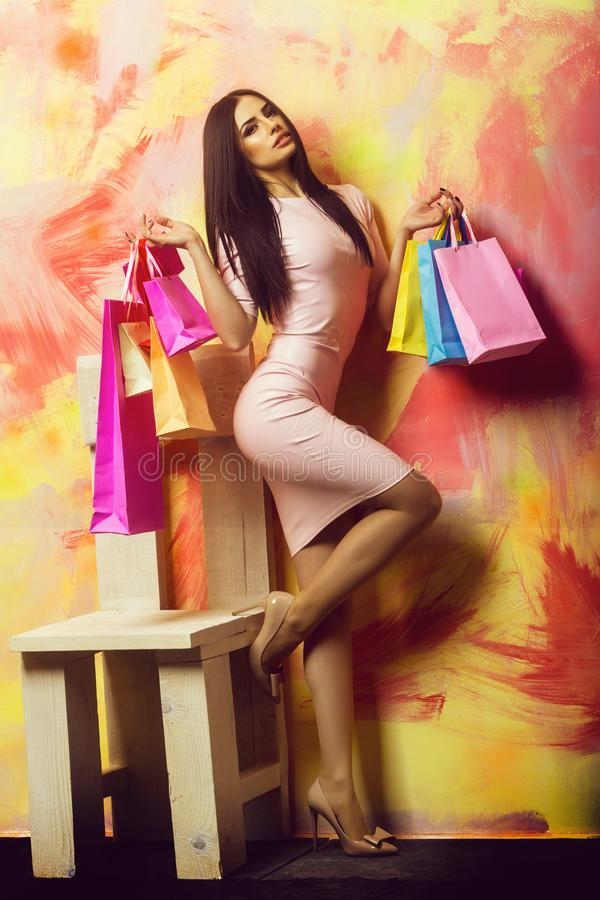 Free Pretty Sexy Woman With Shopping Bags On Colorful Background Royalty Free Stock Photography - 151316267