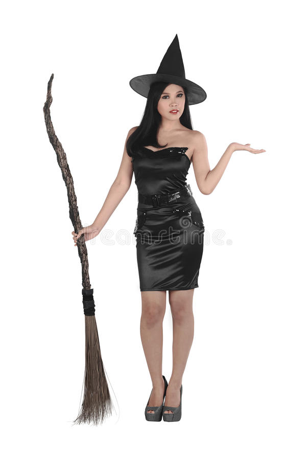 Pretty young asian witch woman with a broom royalty free stock photo
