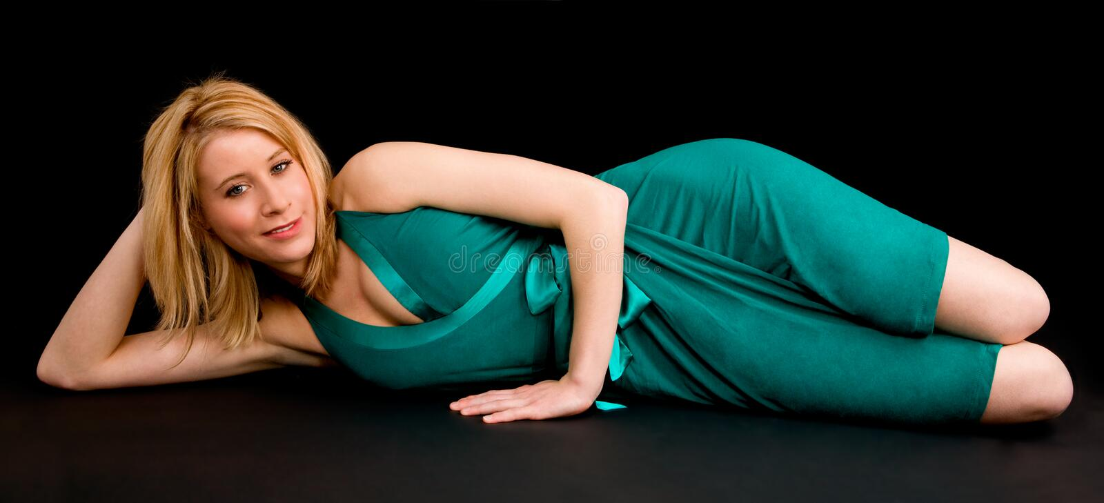 Pretty Smiling Blonde Lying Down And Relaxing Royalty Free Stock Photography