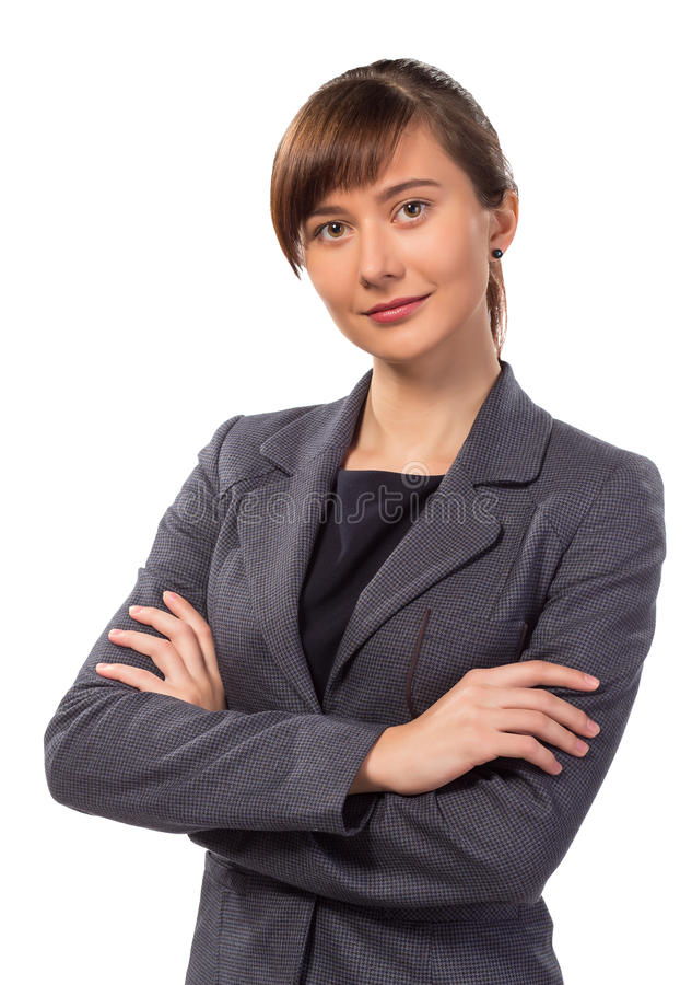 Pretty smiling businesswoman or teacher with arm folded isolated. On white background stock photography