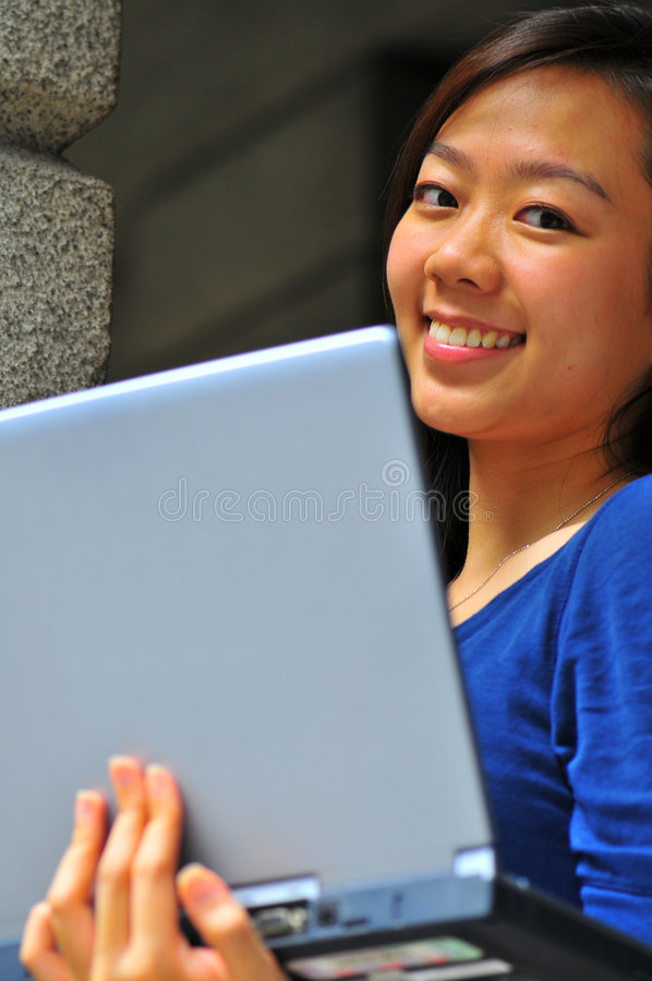 Pretty Smiling Chinese Girl Carrying Notebook stock images