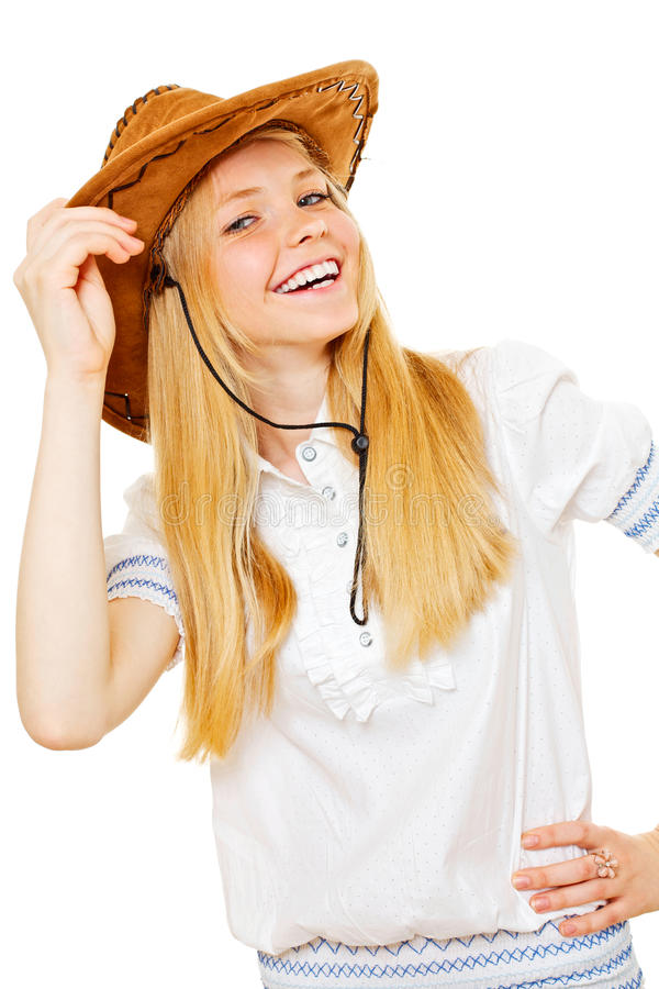 Pretty smiling cowgirl in hat and white blouse stock photography