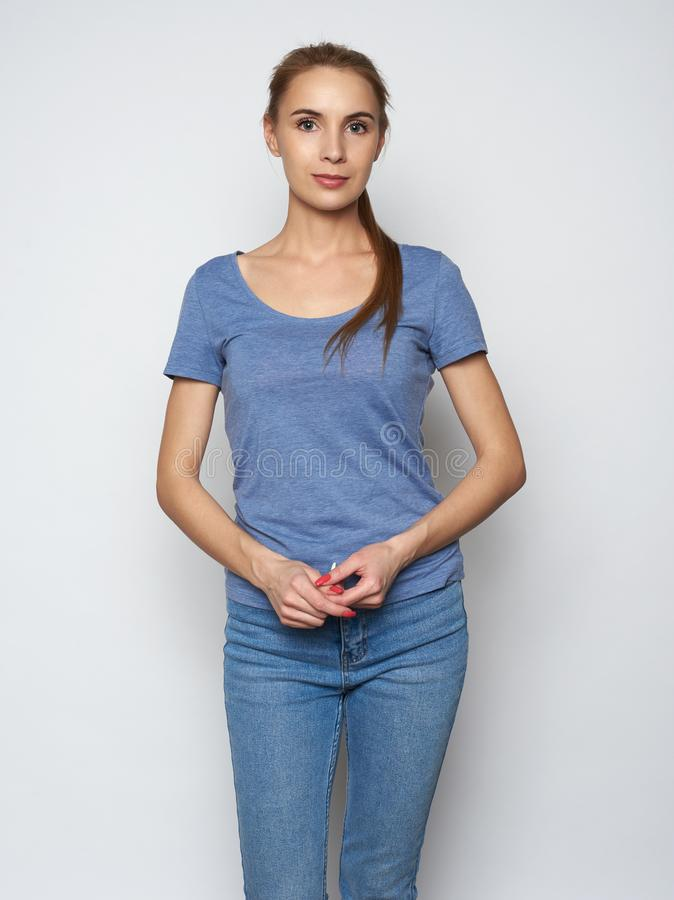 Pretty smiling girl dressed casually looking at camera stock photography