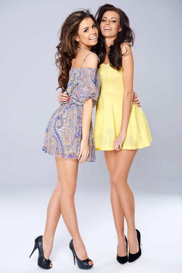 Pretty Smiling Ladies in Dress stock image