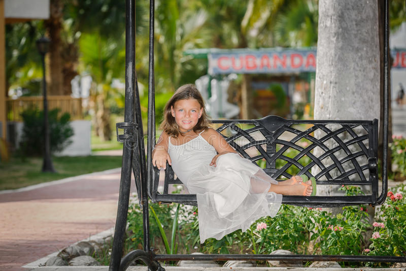 Pretty , smiling little girl relaxing on old vintage royalty free stock images