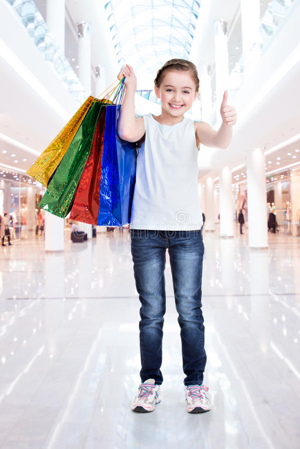 Download Pretty Smiling Little Girl With Shopping Bags Stock Photo - Image: 38320060