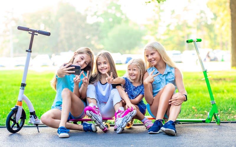 Pretty smiling little girls taking photo stock image