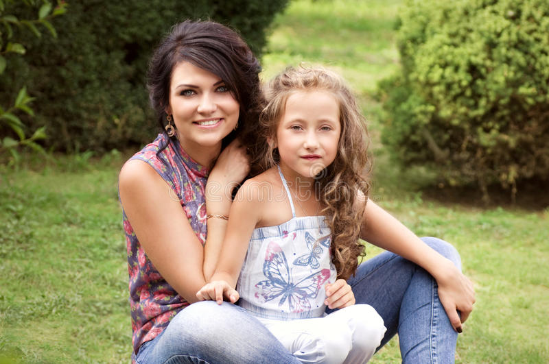 Pretty smiling mother and daughter stock photos