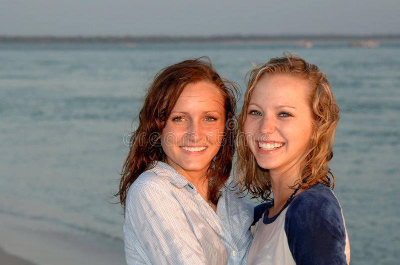 Pretty smiling teen faces at beach royalty free stock photos