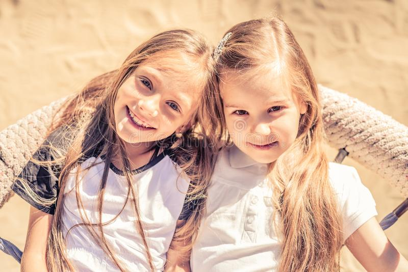 Pretty smiling teenage girls sit lying together royalty free stock images