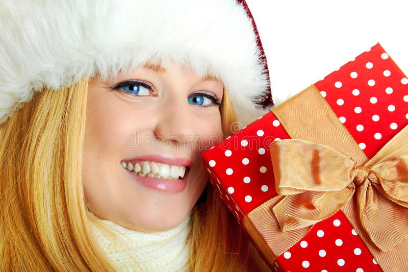 Pretty smiling woman with christmas gift royalty free stock photography