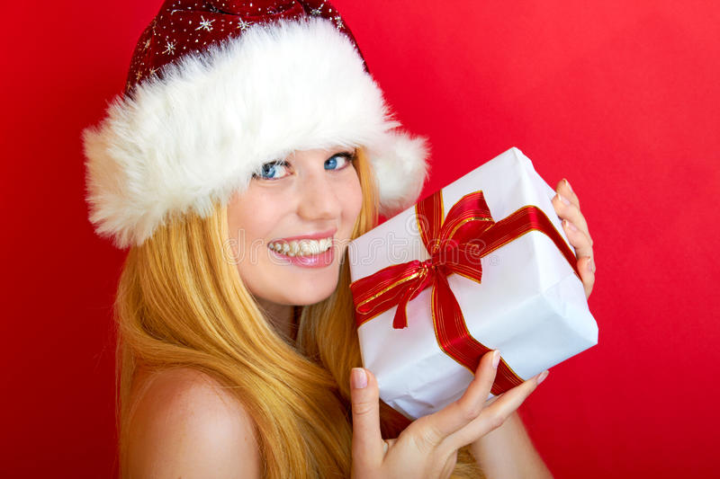 Pretty smiling woman with christmas gift stock photo