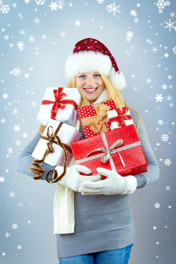 Pretty smiling woman with christmas gift royalty free stock images