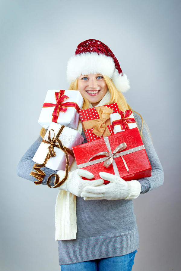 Pretty smiling woman with christmas gift stock photography
