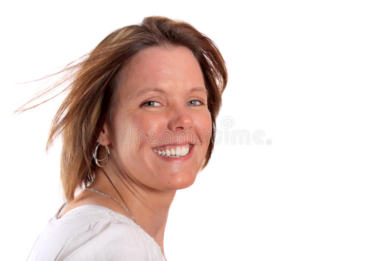 Pretty smiling woman in her thirties royalty free stock image