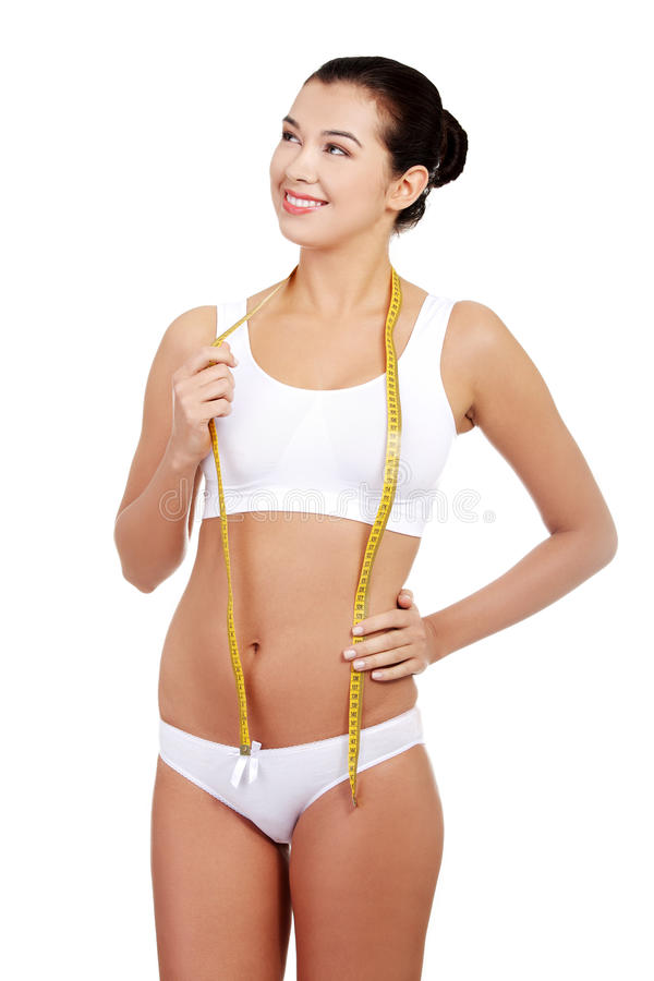 Download Pretty Smiling Woman With Measurement Type Stock Photo - Image: 28208384